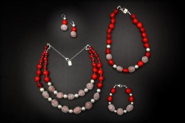 Red Huayruros and sterling silver pop against a black display!