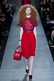 Marc by Marc Jacobs Fall 2013 models sported red lips that complimented their head-to-toe red look. (Photo credit: Imaxtree).